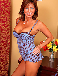 Anilos Tara Holiday flaunts her mature cougar confines in pretty lingerie