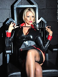 Horny Mistress Lucy Zara strips withdraw in dungeon whilst playing yon her kinky bondage gear