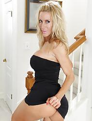 Gorgeous older flaxen-haired Pamela Rivett spreads her pussy lips.