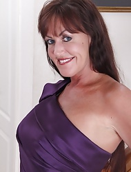 Horny elder babe Cynthia Davis peels absent purple dress.
